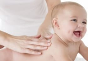 Ease Growing Pains with Infant Massage